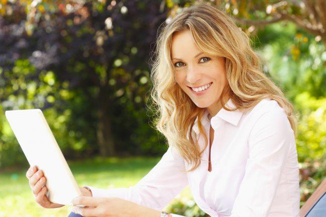 Mature woman portrait with digital tablet